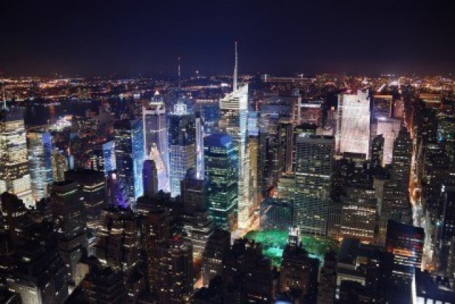 8499676-new-york-city-manhattan-times-square-panorama-aerial-view-at-night-with-office-building-skyscrapers-