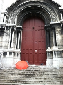 My orange umbrella and sketch haven in the north doorway of the Sacre Ceour.